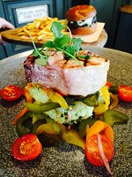 Grilled swordfish, pickled peppers, Jersey Royals, olives
