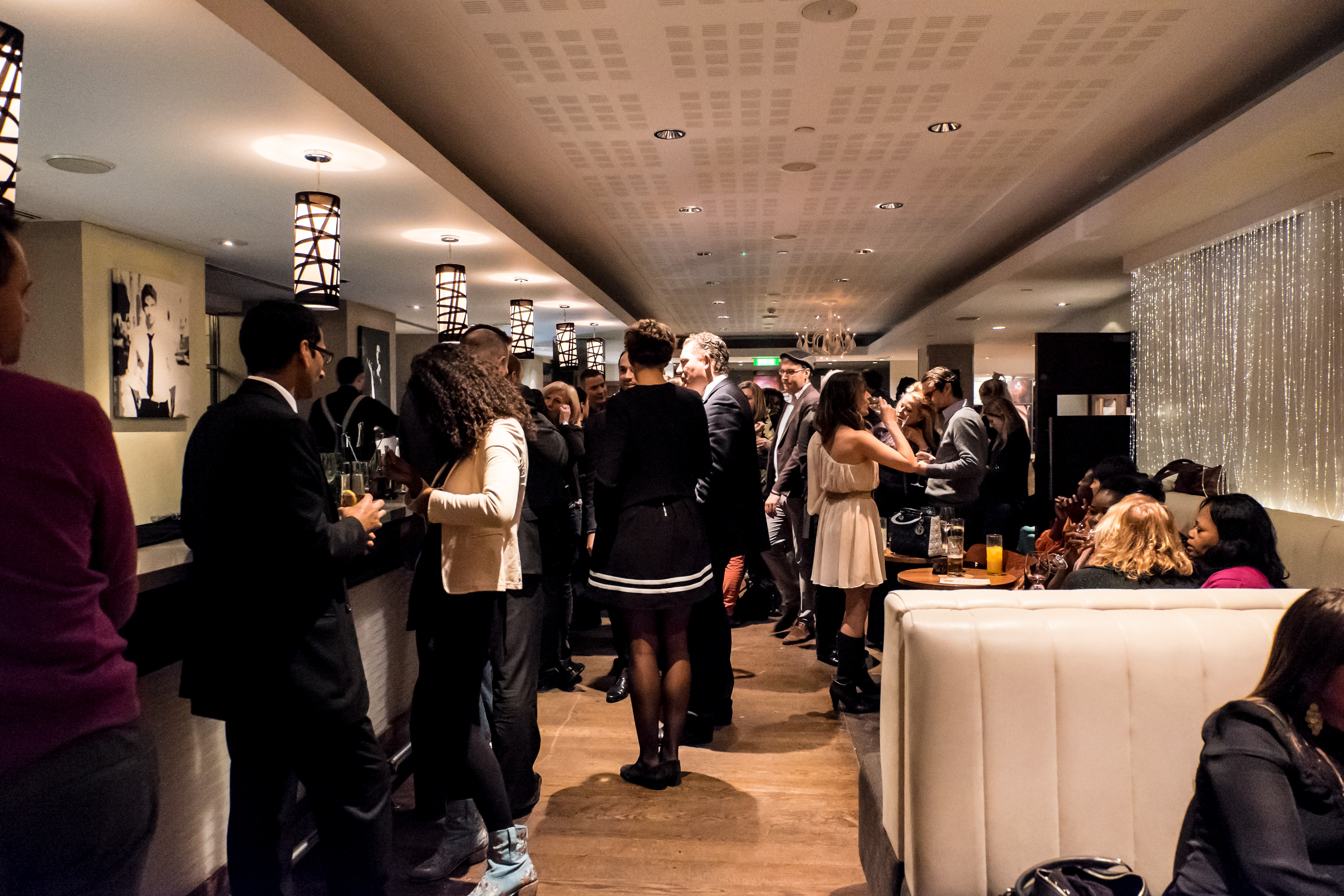 Voltaire Cocktails & Champagne Bar_lounge people-1.jpg