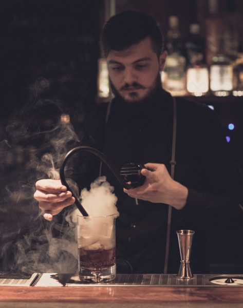 WE EVEN HAND SMOKE OUR COCKTAILS